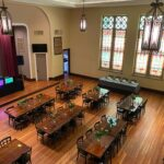 Monarch Events Center handmade tables and stained glass windows